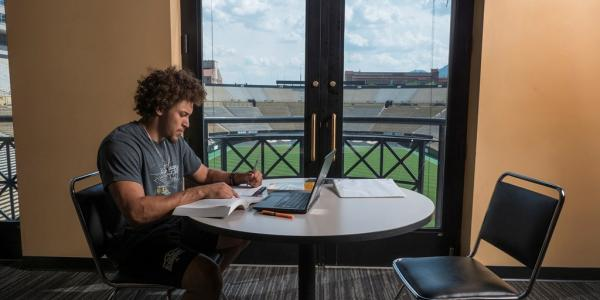 Phillip Lindsay studying on campus