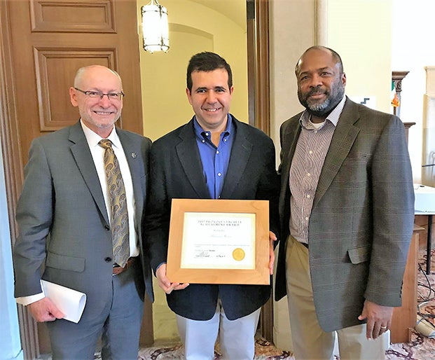 Provost Russell L. Moore (left) and Smead Aerospace department chair Professor Brian M. Argrow with Professor Hussein at the 2017 Fall Convocation where Hussein received a Provost's Faculty Achievement Award for Tenured Faculty.