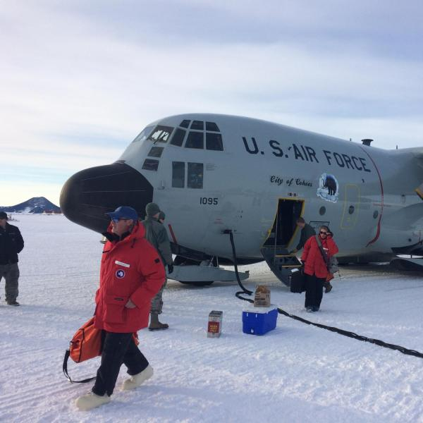 C-130 lands directly on the Ross Ice Shelf to bring passengers and cargo to McMurdo Station