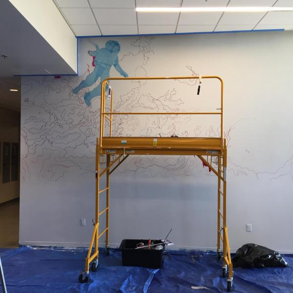 Early work on Ellie Marcotte's mural