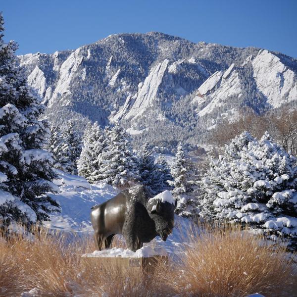 Snow on the Flatirons mountains.