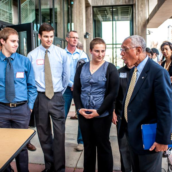 Lea Harris explains to NASA Administrator Bolden how the DARE rover can ascend/descend inclines up to 70 degrees