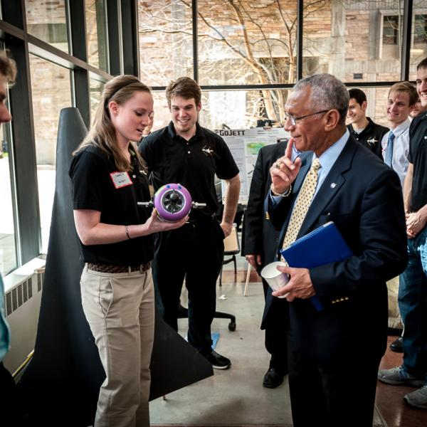 Cheryl Bloomberg of GOJETT graduate project describes the propulsion of the supersonic unmanned aerial system  (UAS) with NASA Administrator Charles Bolden