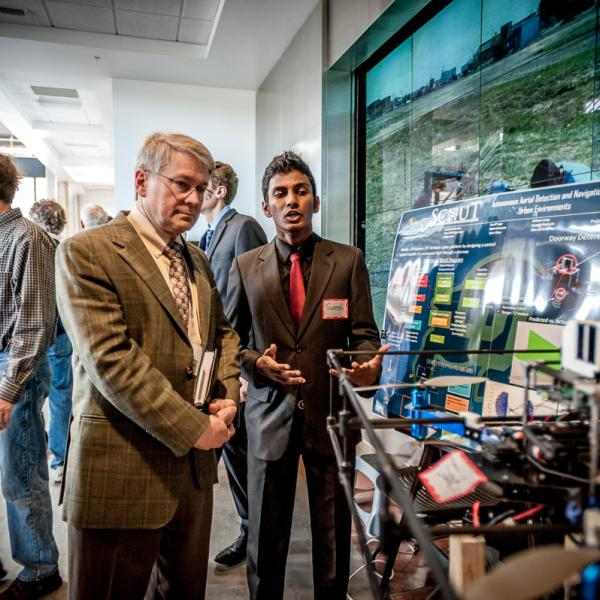 John Langford, CEO Aero Flight Services is briefed on the aerial capabilities of SCOUT senior design project by Sureshratnam Nagaratnam