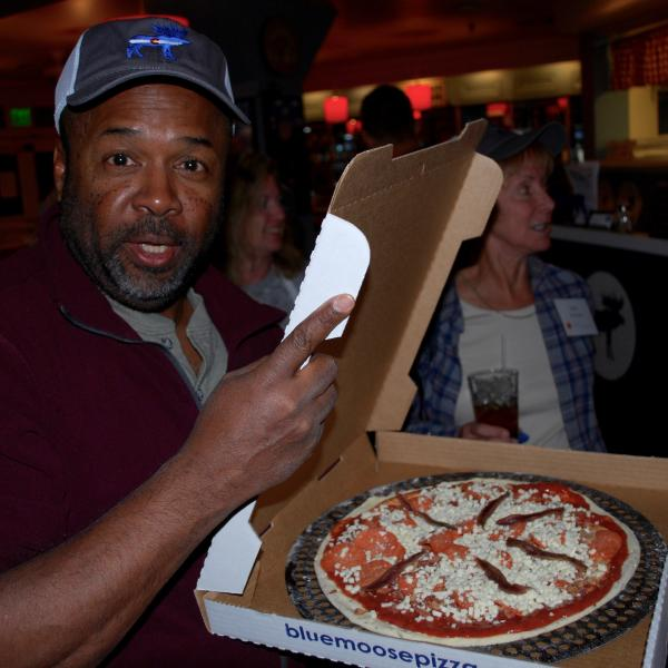 Brian Argrow with a pizza.
