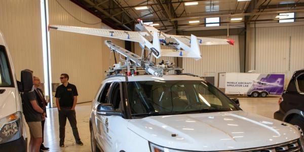 A UAV mounted to a car.
