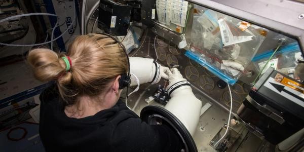 A NASA astronaut conducting work aboard ISS.