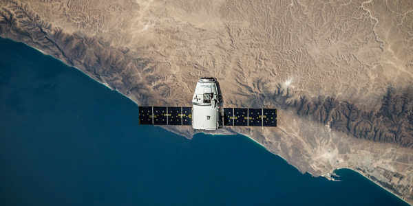 SpaceX capsule floating over Earth.