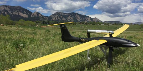 Unmanned Aircraft at rest with the flatirons in the background.