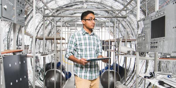 Student inside the bioastronautics space station habitat.