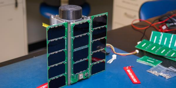 CubeSat on a work bench.