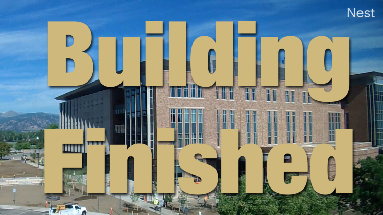 "Photo of the building with overlaid text saying ""Building Complete"""