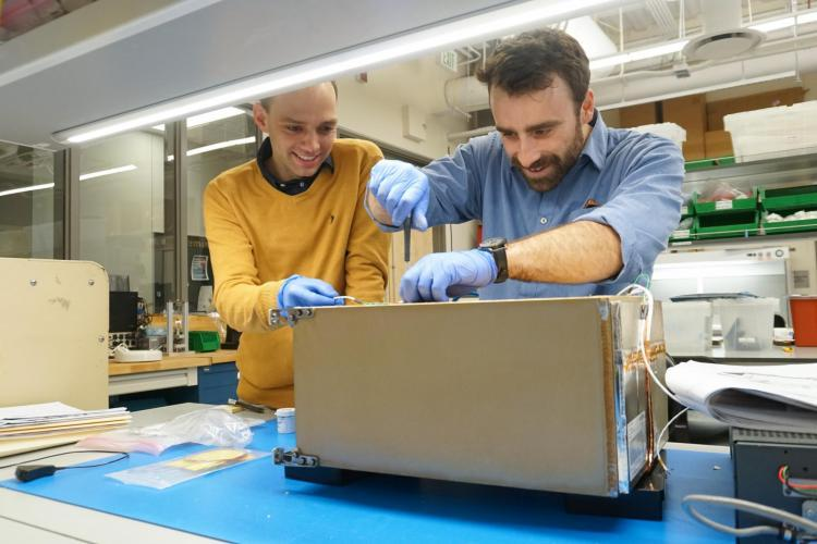 Tobias Niederwieser and Robby Aaron working on one of the FRIDGE units.