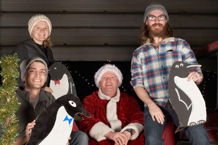 Jandreau with two colleagues and Santa.
