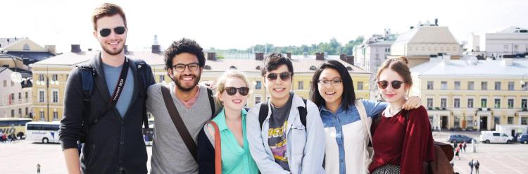 CU Boulder students pose on street in Sweden during study abroad