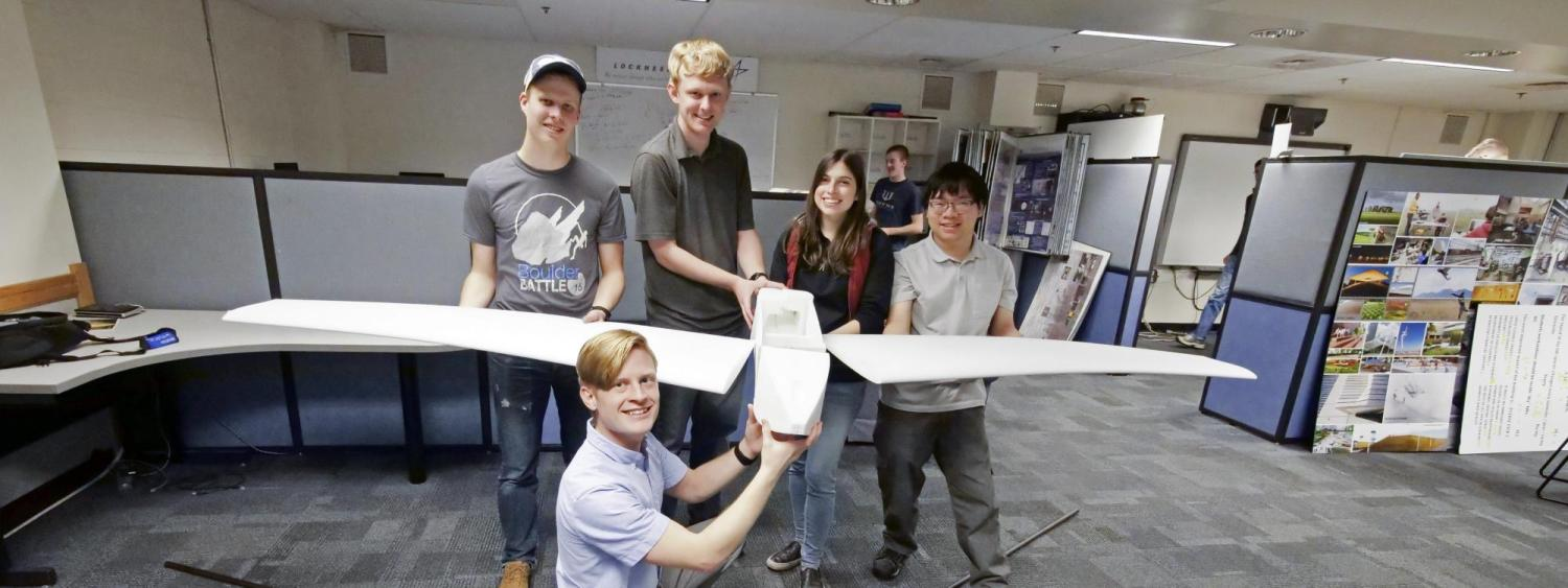 Students holding the drone.