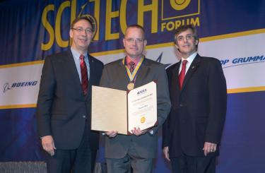 HP Schaub at the SciTech forum with the Atwood Award.
