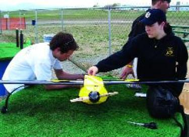 Osborn and Linsay Marek test their 2005 V-tail aircraft at the Boulder Aeromodelers Field