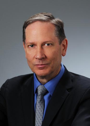 Timothy K. Minton