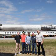 Members of the science and implementation team at Kennedy Space Center with a space-proven Falcon 9 rocket on the background. From left to right: Eric Yarns (KU), Kevin Ngo (KU), Luis Zea (CU Boulder), Dr. Joe Tash (KU), and Sam Piper (CU Boulder)