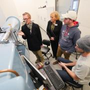 Dr. Paccione meets with aerospace engineering student in a wind tunnel lab during her campus visit Wednesday.