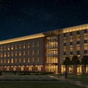 A night rendering of the new building design.