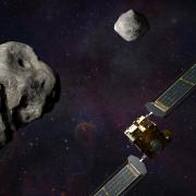 Illustration of NASA's DART spacecraft and the Italian Space Agency's (ASI) LICIACube prior to impact at the Didymos binary system.