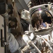 An astronaut on a spacewalk.