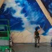 Trine Bumiller at work on her mural.