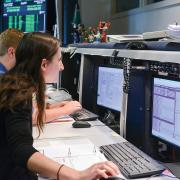Students in the mission operations center at the Laboratory for Atmospheric and Space Physics in Colorado communicate with a satellite.