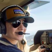 Wexler piloting a private plane.