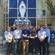 The MinXSS team outside the Small Sat conference with the award.