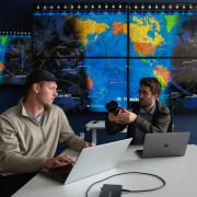 Graduate students Michael Klonowski, left, and Daniel Aguilar-Marsillach, right, work in the Raytheon Space & Intelligence Vision, Autonomy, and Decision Research Lab at CU Boulder, which studies new methods for tracking and managing satellite traffic in space.
