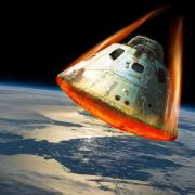 A space capsule reentering the atmosphere.