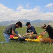Three people working on a UAV.