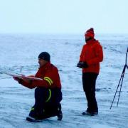 CU Boulder Research Scientist Gijs de Boer prepares to launch a DataHawk to collect atmospheric measurements as sea ice is forming in far northern Alaska.