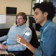Lahijanian speaking with a student in his lab.