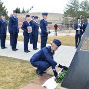 A cadet placing a wreath.