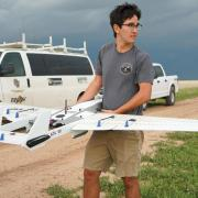 A student holding the RAAVEN drone.