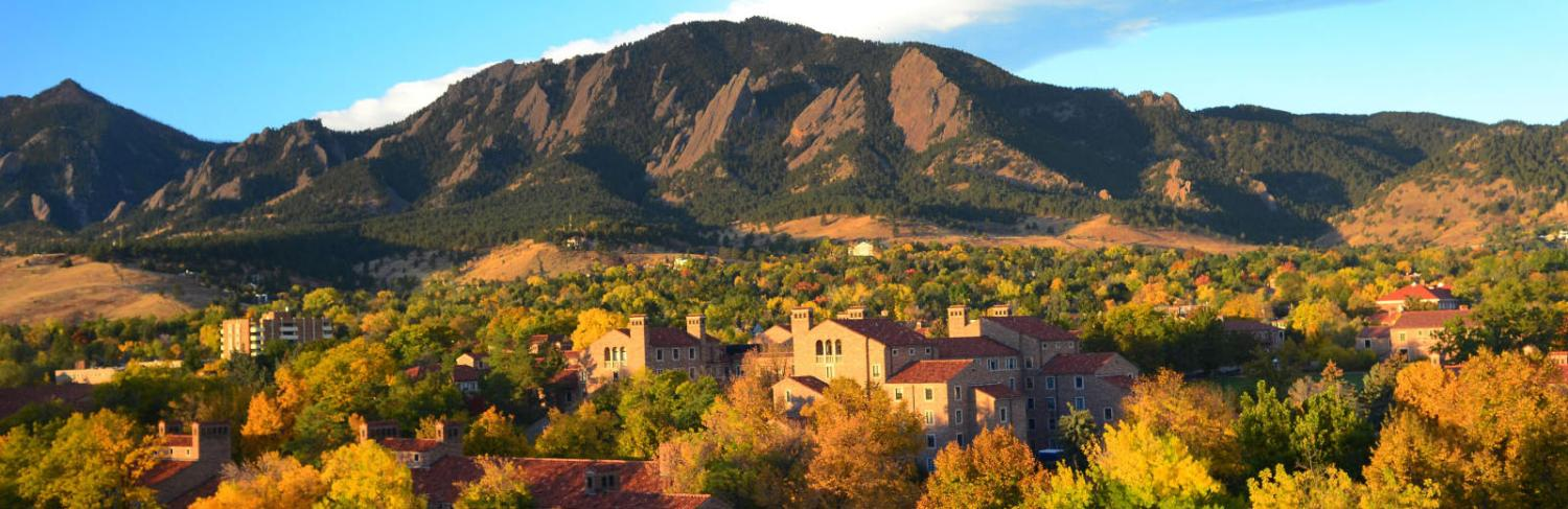 Campus and the Flatirons at sunset on a fall day