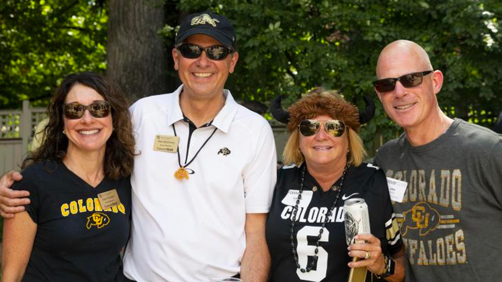 CU Boulder alumni fans connecting at a football game