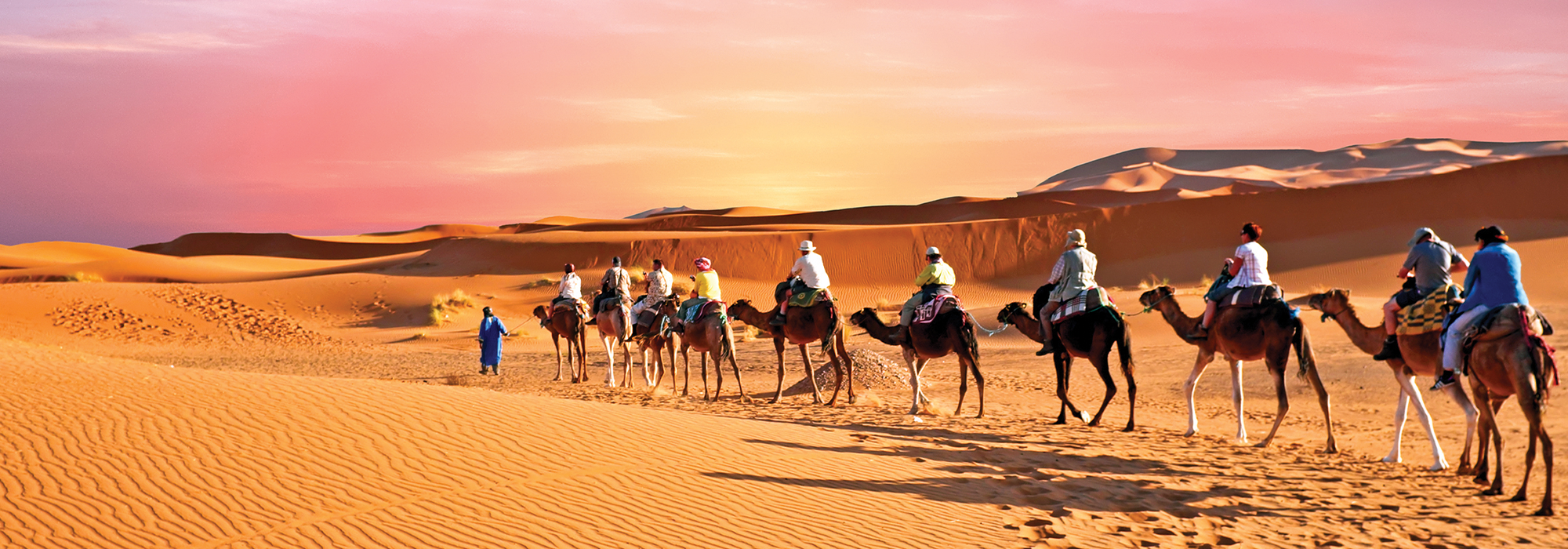 Travelers ride by camel during a trip to Morocco