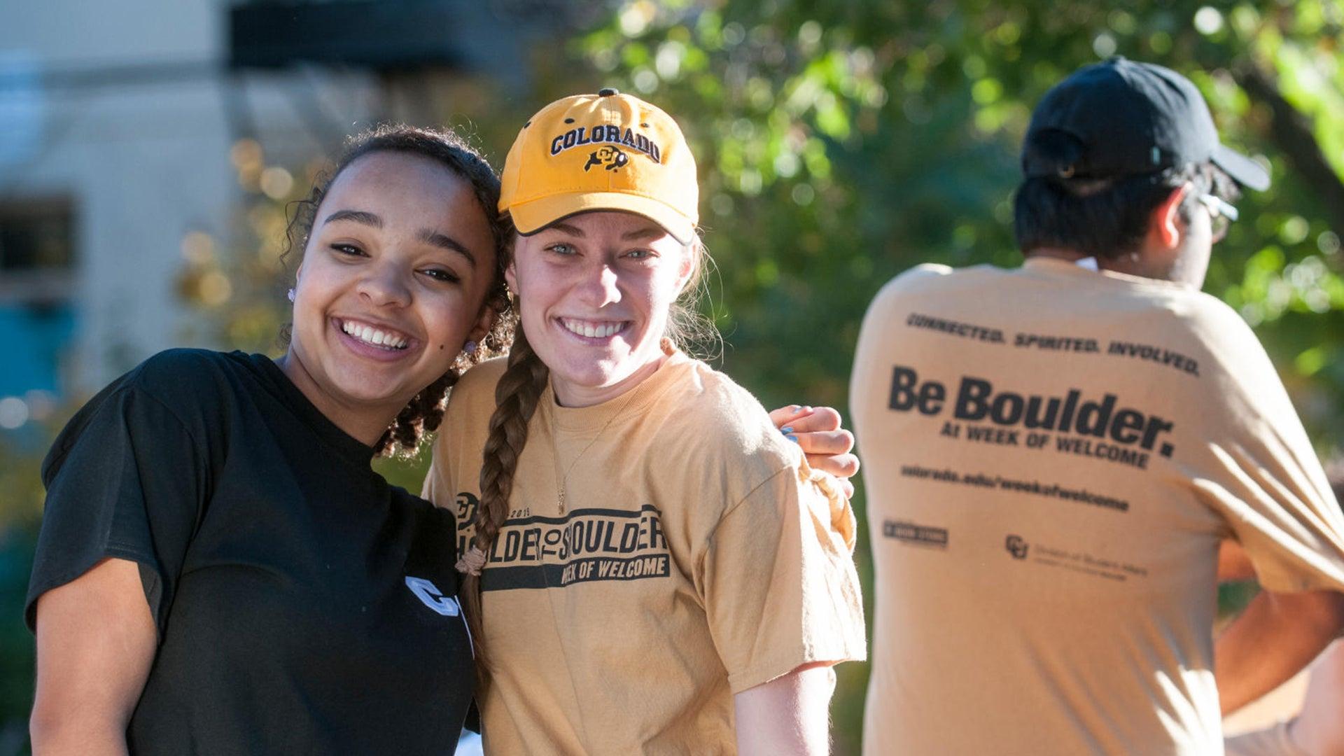 Two CU Boulder alumni hugging at a volunteer event