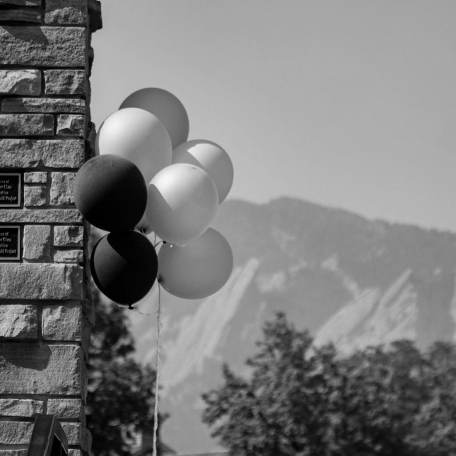 CU balloons in front of the flatirons