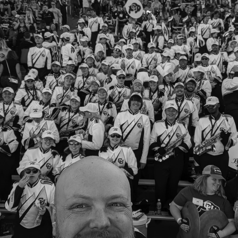 Photo of CU band behind an alum