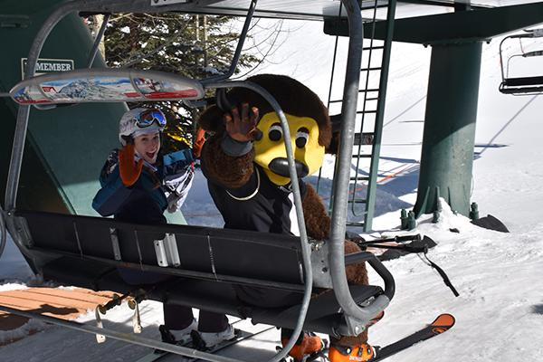 CU Alumnus and Chip wave from a ski lift