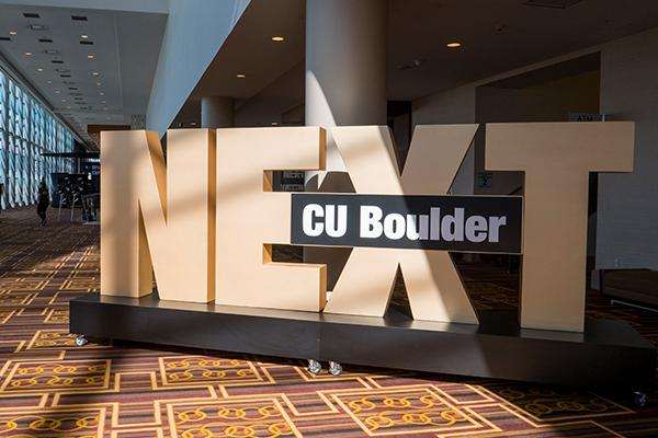 """Conference sign that reads """"CU Boulder NEXT"""""""
