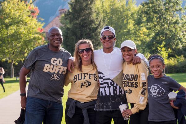 A multi-generational family in CU Boulder gear