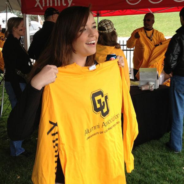 Student holding CU Buffs shirt