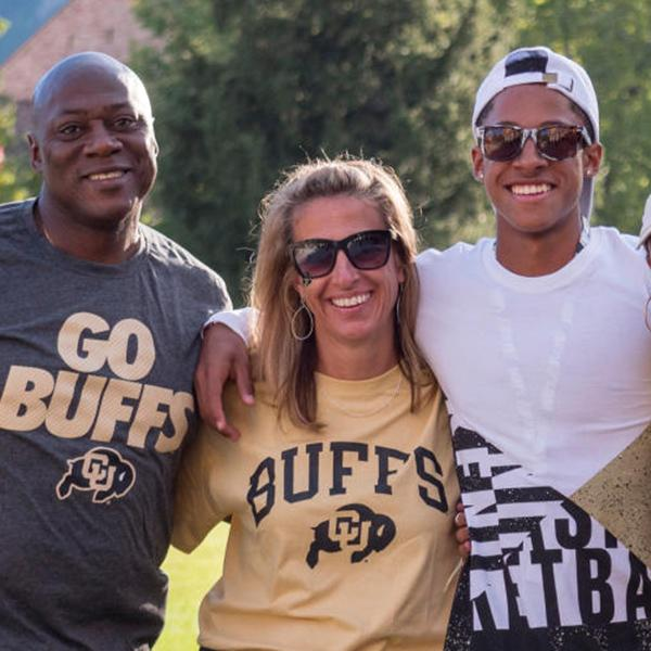 family wearing cu boulder tshirts